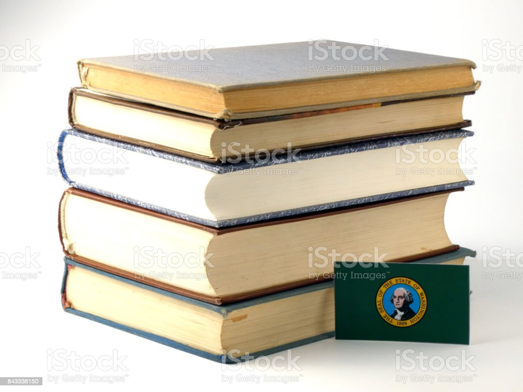 Washington flag with pile of books isolated on white background stock photo