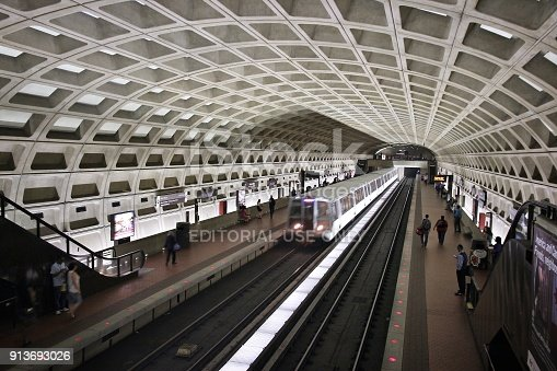 Washington: People wait for subway train in Washington. With 212 million annual rides in 2012 Washington Metro is the 3rd busiest rapid transit system in the USA.