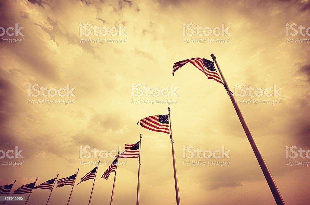 Washington Monument and US flag stock photo
