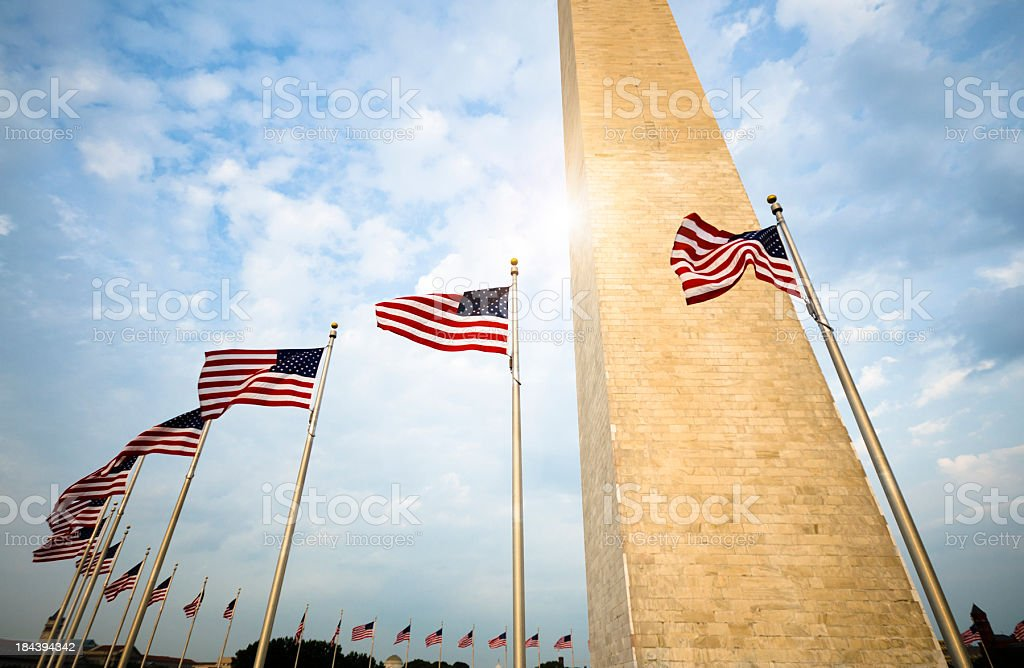 Washington Monument and US flag stock photo