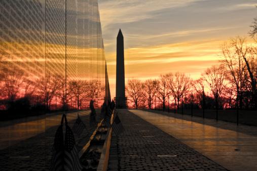 Washington, D.C. USA - January 31, 2014: The Washington Monument and Vietnam Memorial Wall at Sunrise