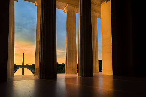 washington monument from lincoln memorial at sunrise in washington, dc - monument bildbanksfoton och bilder