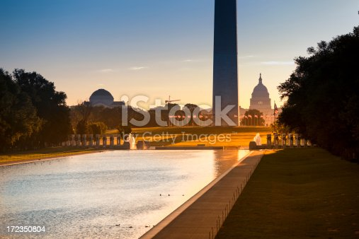 Washington DC Monument and the US Capitol Building and grounds viewed across the reflecting pool from the Lincoln Memorial on The National Mall USA
