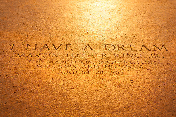 "Washington Monument from the Lincoln Memorial Washington D.C., USA - September 23, 2012: Martin Luther King quote inscription on the steps of the Lincoln Memorial on The National Mall.  ""I Have a Dream"" was a public speech delivered by American civil rights activist Martin Luther King Jr. on August 28, 1963, in which he calls for an end to racism in the United States. Delivered to over 250,000 civil rights supporters from the steps of the Lincoln Memorial during the March on Washington, the speech was a defining moment of the American Civil Rights Movement. mlk stock pictures, royalty-free photos & images"