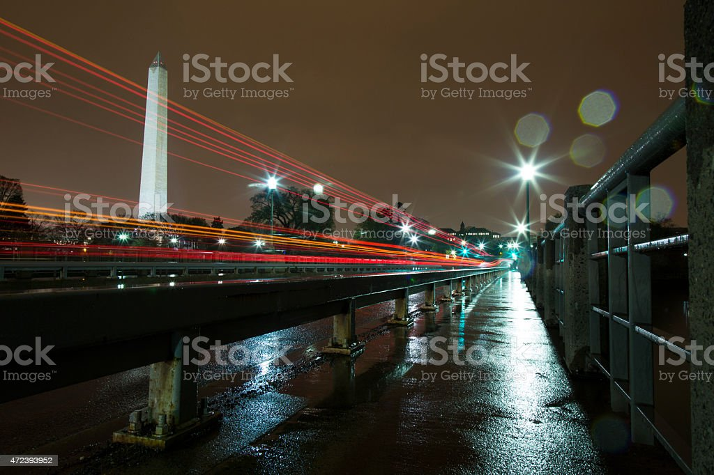 Washington Monument Lit Up at Night in the Rain stock photo