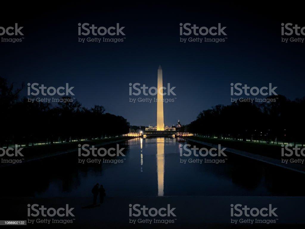 Washington Monument obelisk illuminated at night in Washington D.C. stock photo