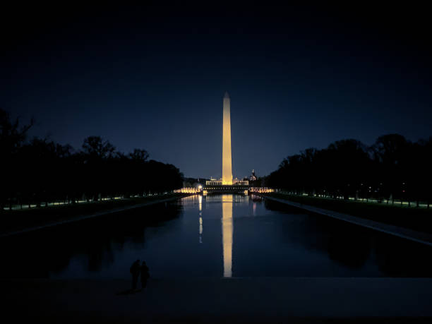 Washington Monument obelisk illuminated at night in Washington D.C. stock photo