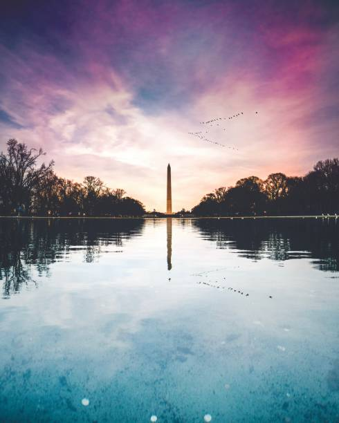 Washington Monument Washington Monument at sunset in front of the reflecting pool. monument stock pictures, royalty-free photos & images