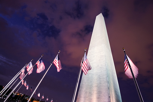 Washington Monument With American Flags Along National Mall At Night Stock Photo - Download Image Now