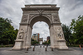 New York City, United States of America - July, 2018. People pass through Washington Square Park.