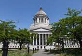 This image shows the exterior of the Washington State Legislative Building at the State Capitol campus in Olympia, Washington.