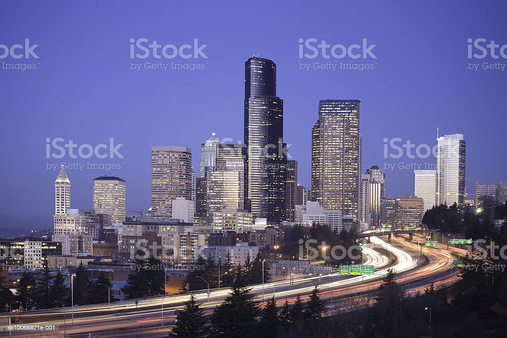 USA, Washington State, Seattle skyline and highway at dawn 免版稅 stock photo