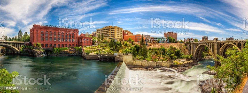 Washington Water Power building and the Monroe Street Bridge along the Spokane river stock photo