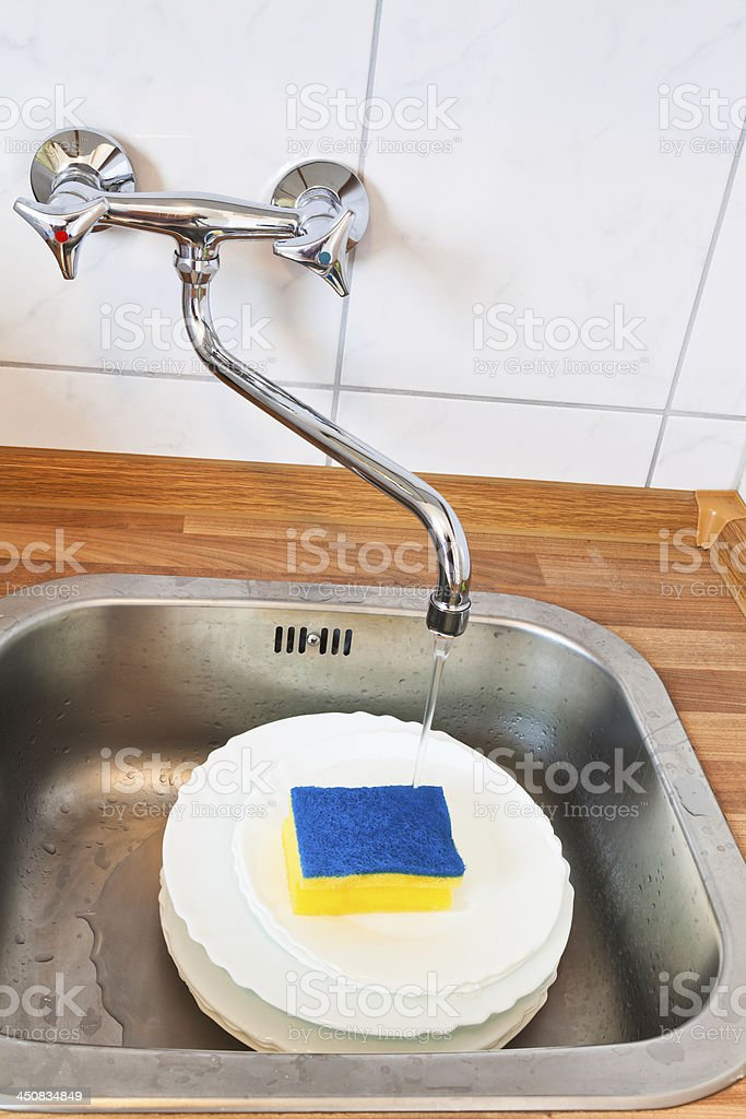 washing-up by cleaning sponge stock photo