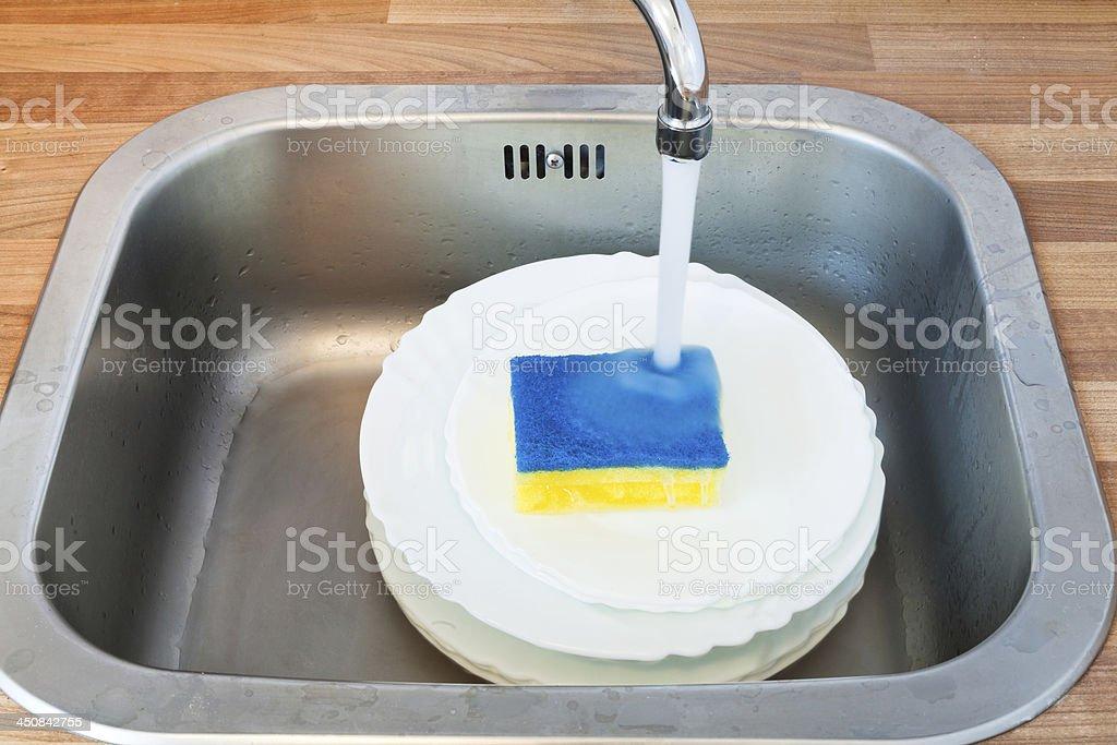 washing-up by dish sponge stock photo
