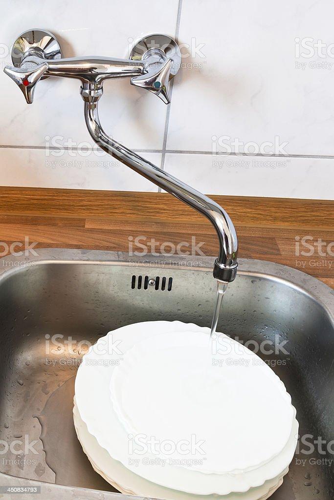 washing-up in metal washbasin stock photo