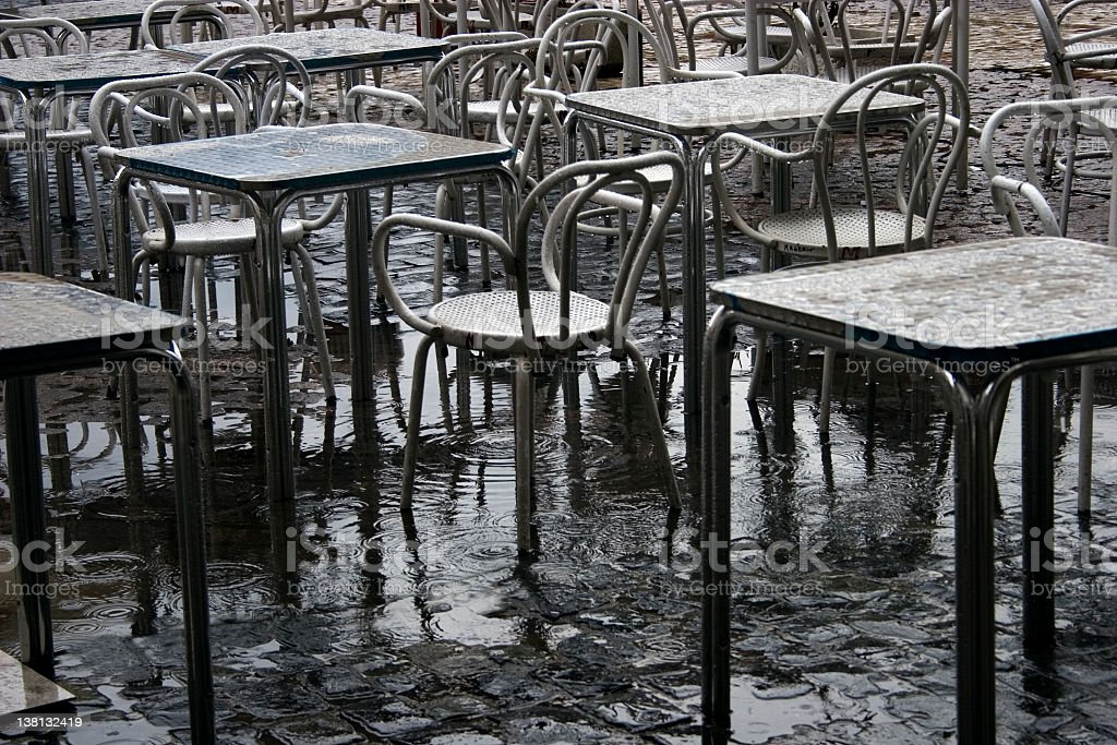 washout - tables in the rain royalty-free stock photo