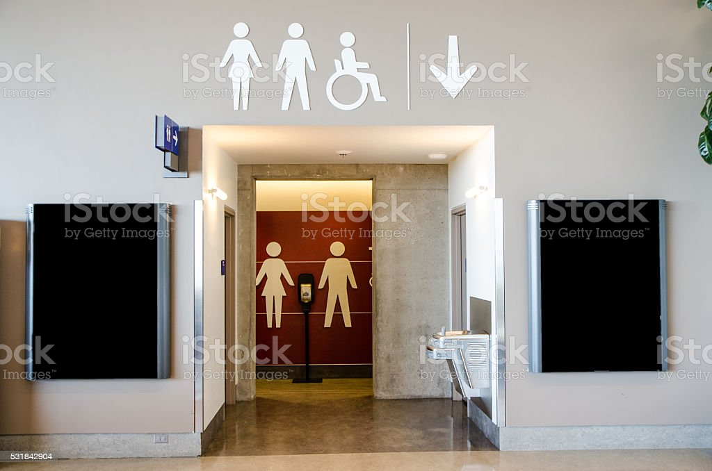 Washroom entrance with advertisment sign on each side of door stock photo