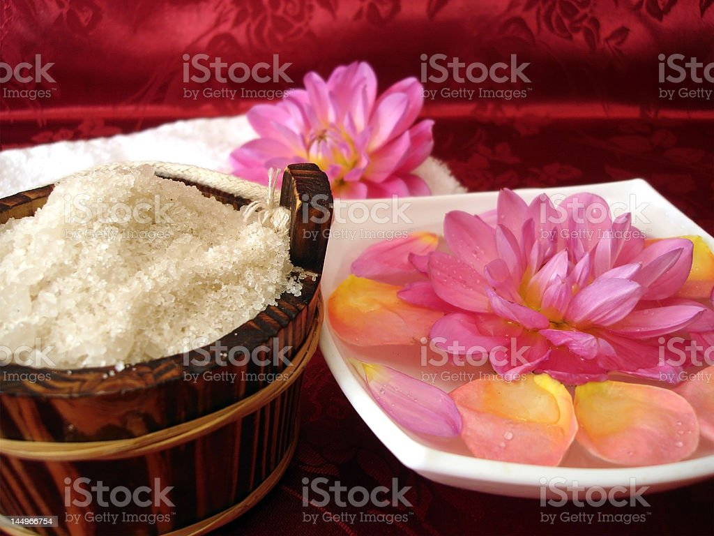 washtub with bath salt, towel and flowers royalty-free stock photo