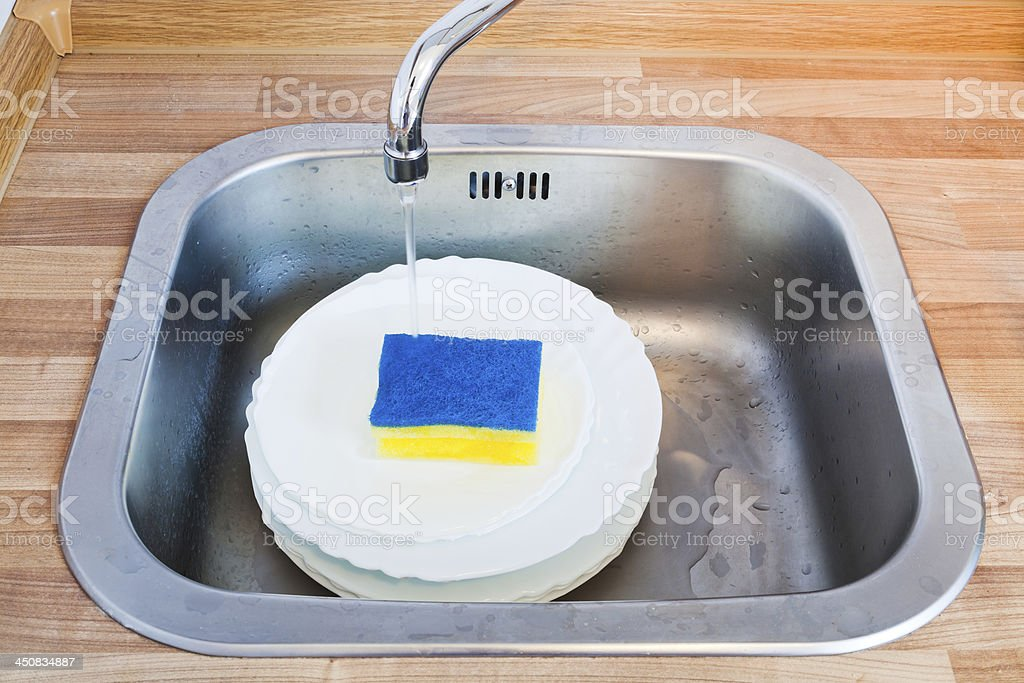 wash-up by cleaning sponge stock photo