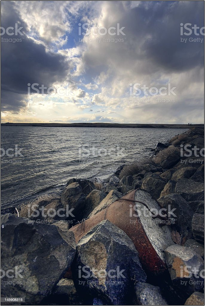 Waste Barrel on the Shore royalty-free stock photo