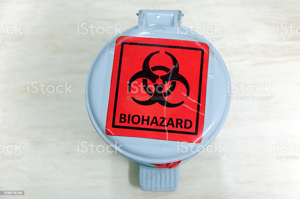 waste bin with biohazard sign stock photo