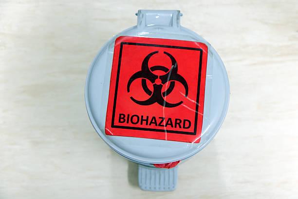 waste bin with biohazard sign stock photo
