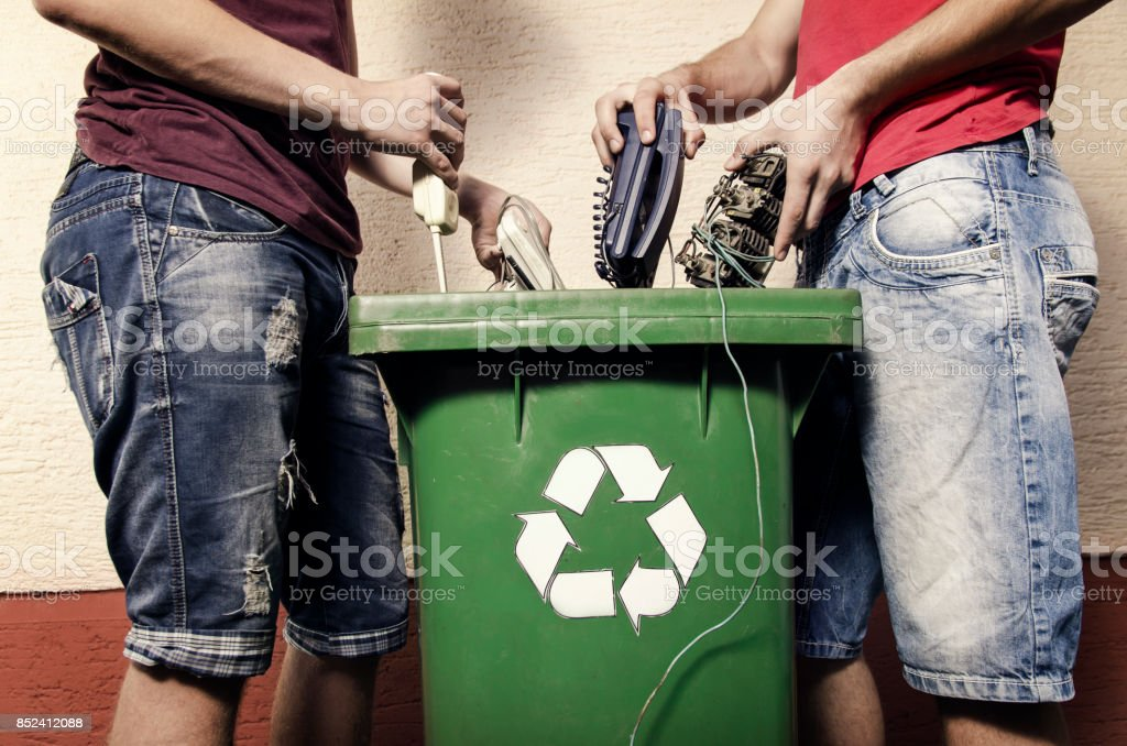 E waste concept, two man throwing electronics stock photo