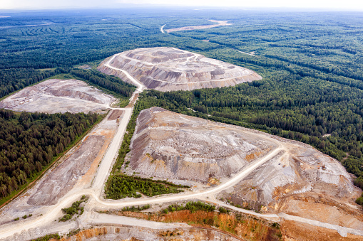 Waste heaps and mountains of rock production from an open pit