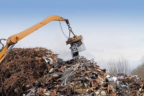 Waste Management, Crane Placing Scrap Metal In Pile,  Ready For Shipping To Recycling Facility stock photo