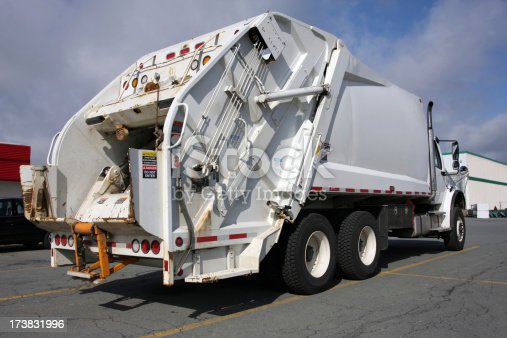Rear quarter view of a waste management truck.