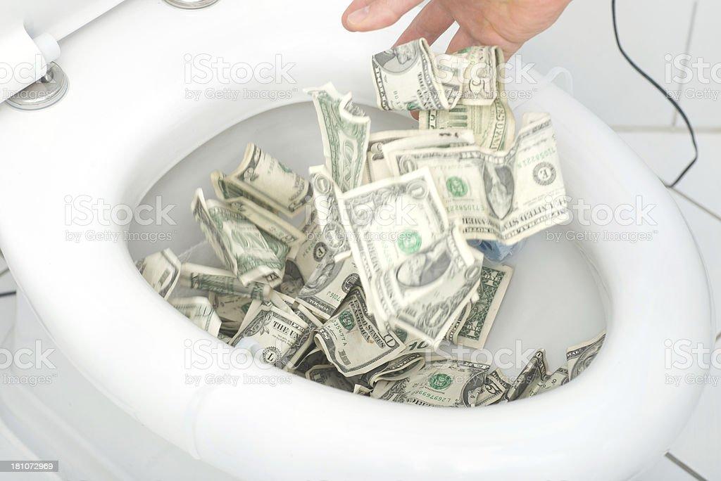 waste money many dollars in toilet stock photo