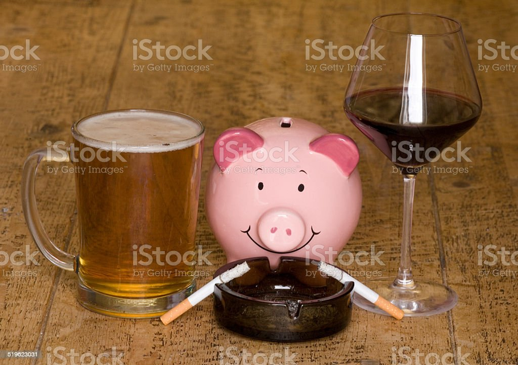 Waste of money smoking and drinking stock photo