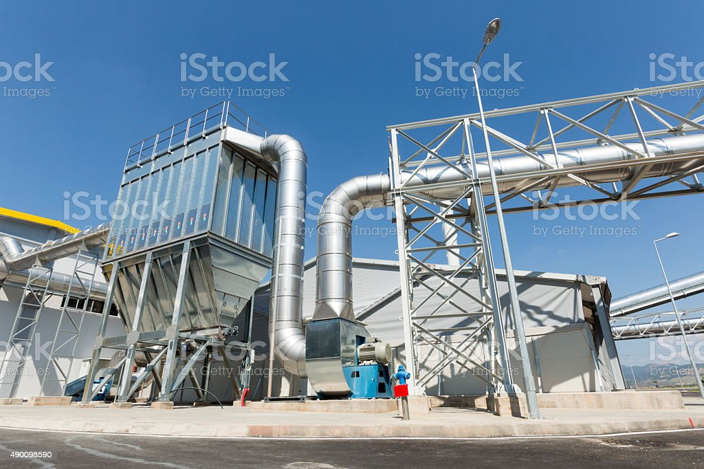 Waste plant pipes sky stock photo