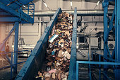 istock Waste processing plant. Technological process. Recycling and storage of waste for further disposal. Business for sorting and processing of waste. 684454790