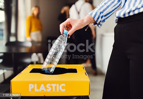 A concept of waste separation and recycling in business office, a midsection.