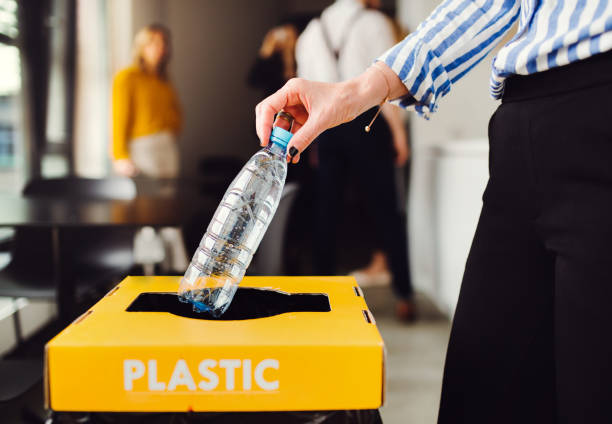 Waste separation and recycling in business office, a midsection. A concept of waste separation and recycling in business office, a midsection. recycling stock pictures, royalty-free photos & images