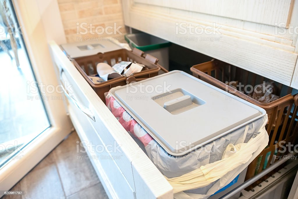 Waste sorting drawer recycling kitchen home chores stock photo