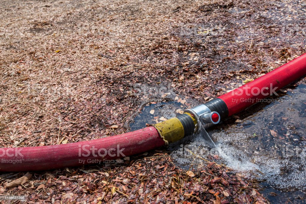 Waste water from pipe leaking. leaking fire pipeline joints. A...