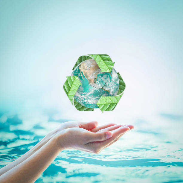 Waste water recycle, eco friendly and saving biological sustainability concept: Elements of this image furnished by NASA - foto stock