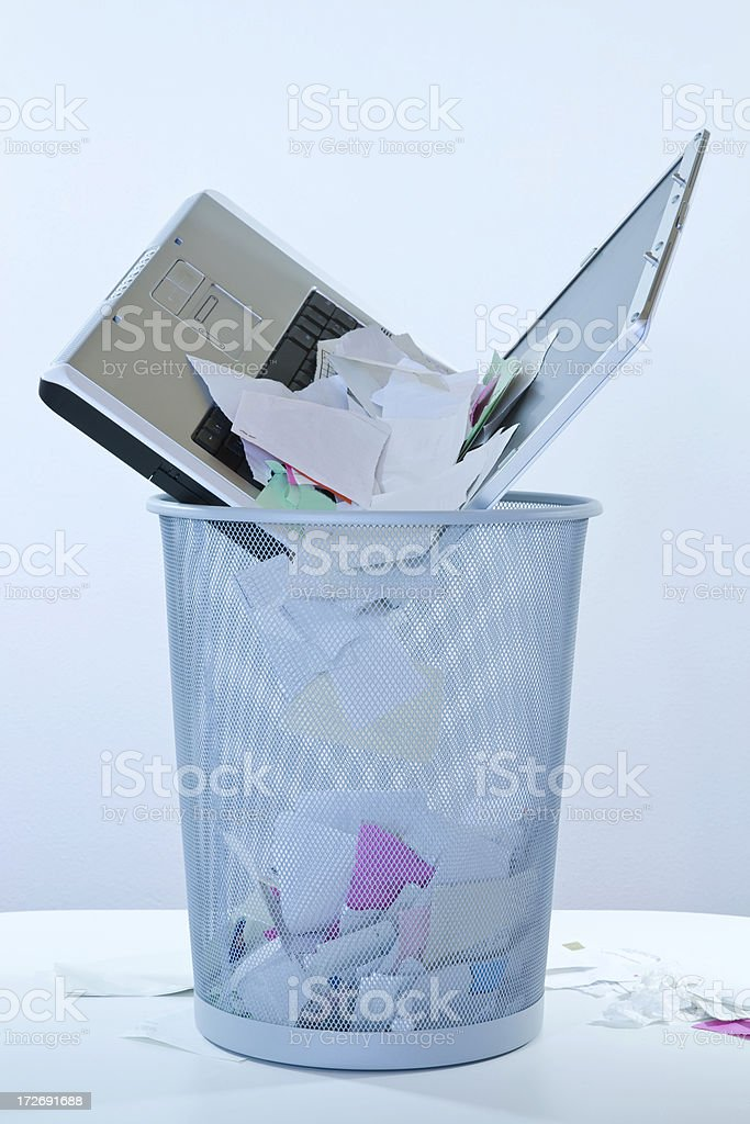 Wastepaper Basket with Laptop stock photo