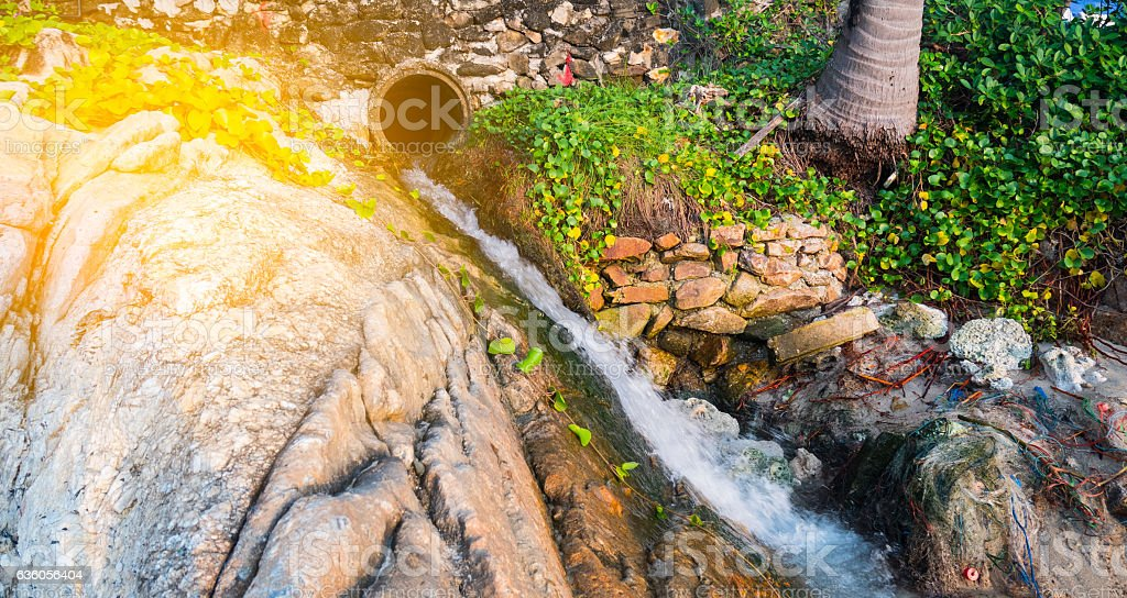 Wastewater discharge pipe at the beach. stock photo