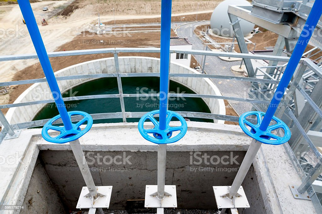 Wastewater treatment facility valves pipes stock photo