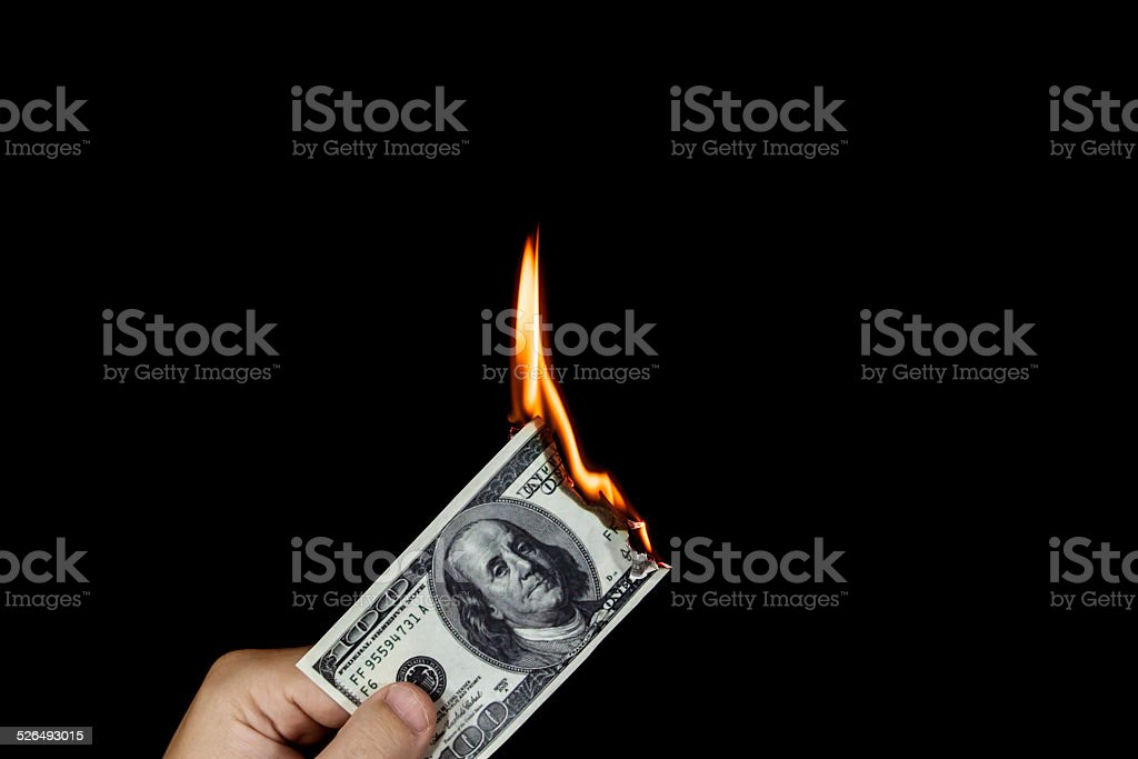 Wasting money stock photo