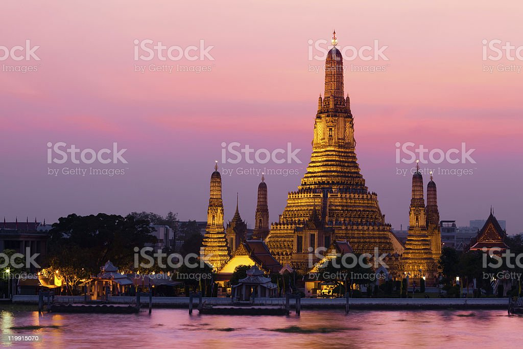 Wat Arun across Chao Phraya River during sunset royalty-free stock photo