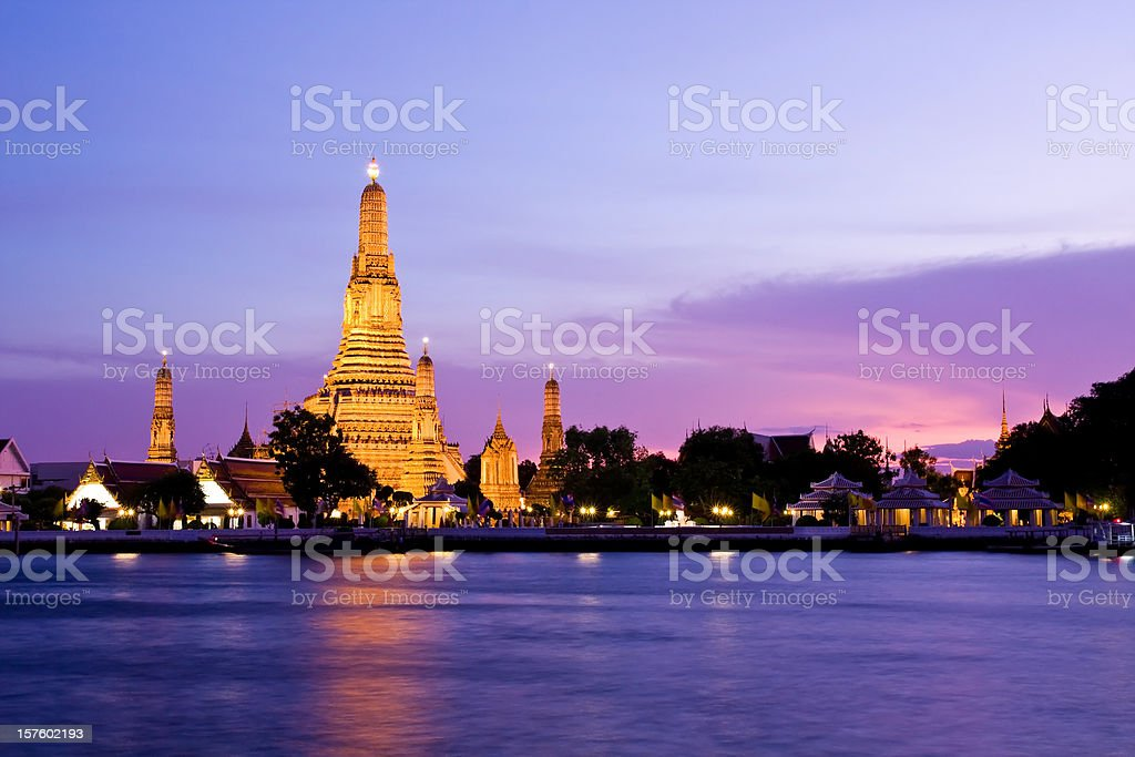 Wat Arun across Chao Phraya River during sunset stock photo