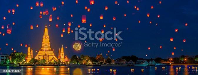 Wat arun in night time and floating lamp in yee peng festival under loy krathong day, Bangkok city ,Thailand