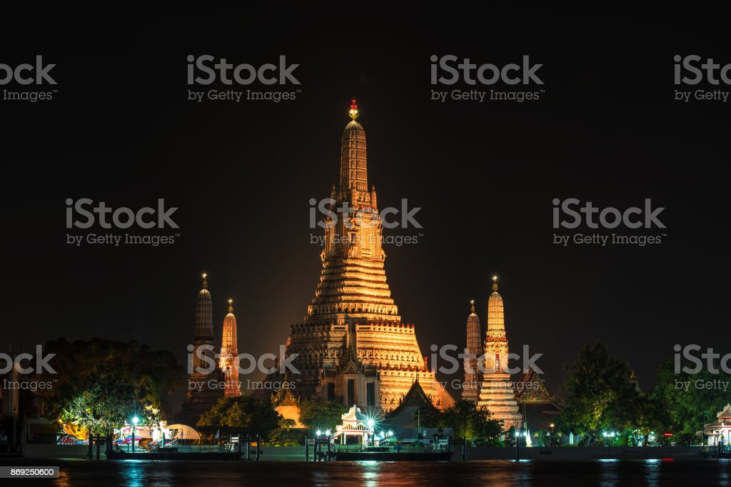 Wat Arun Temple at night in bangkok Thailand. Wat Arun is among the best known of Thailand's landmarks stock photo