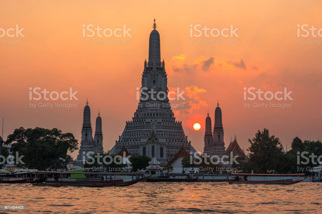 Wat Arun Temple at sunset in bangkok Thailand. Wat Arun is among the best known of Thailand's landmarks stock photo