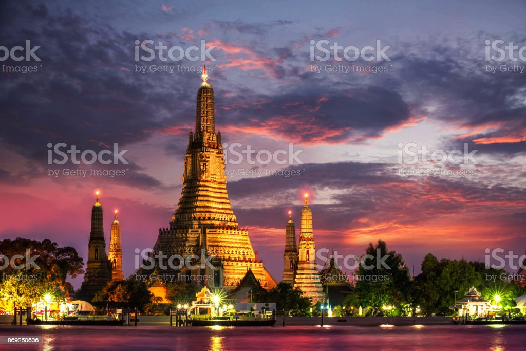 Wat Arun Temple at twilight in bangkok Thailand. Wat Arun is among the best known of Thailand's landmarks stock photo